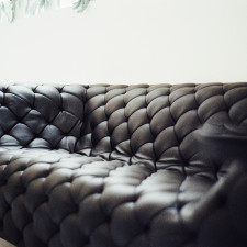 1410619410-black-couch-furniture-living-room.jpg